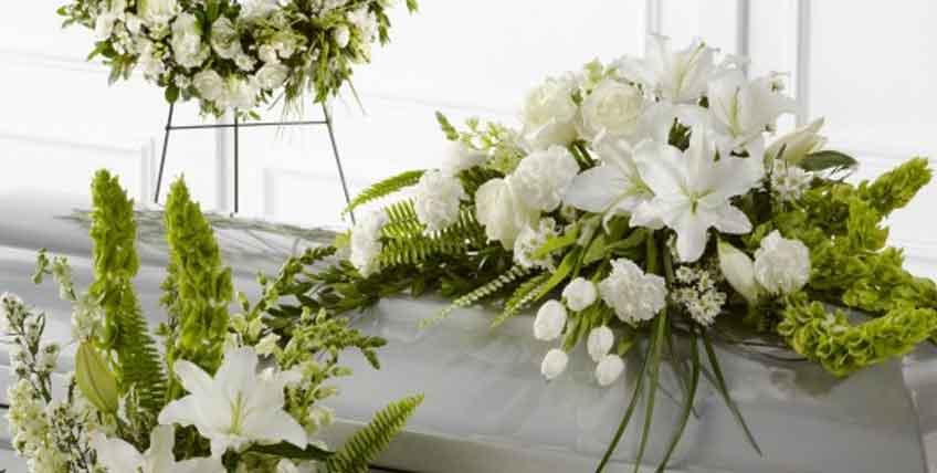Costi fiori e cuscino funebre